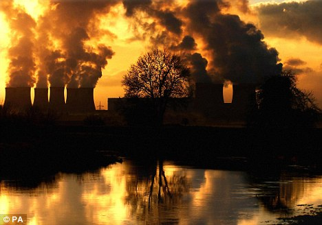 Emissions rising from Drax Power Station near Selby, Yorkshire - the climate change act will cost the UK £18billion a year. If greenhouse gas emissions are halved by 2050, temperature increases could be limited to 2C and catastrophic climate change avoided.